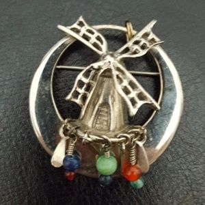 Jewelry - Windmill brooch pin with dangling stones
